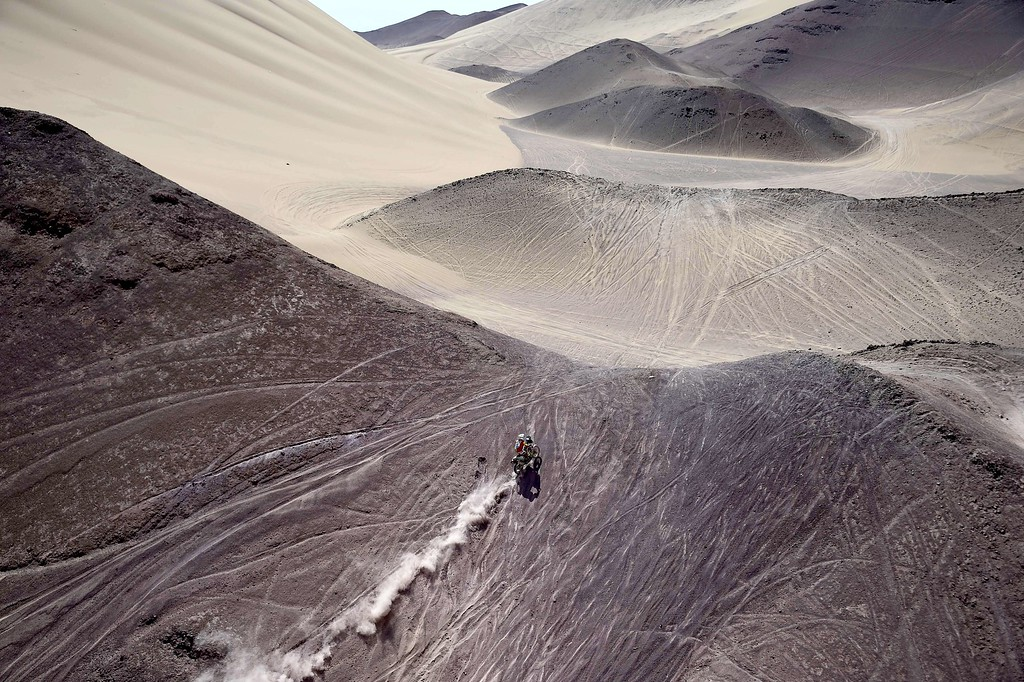 . Italy\'s Paolo Ceci powers his Ktm during 2015 Dakar Rally stage 8 between  Uyuni, Bolivia and Iquique, Chile, on January 12, 2015. The Uyuni salt flat is the largest in the world, located in Bolivia near the crest of the Andes, some 3,650 metres above sea level. FRANCK FIFE/AFP/Getty Images