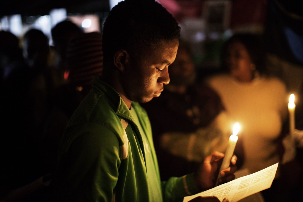 . Parishioners hold a candle light vigil for Nelson Mandela outside the Mediclinic Heart Hospital in Pretoria where the ailing former South Africa\'s president Nelson Mandela is hospitalised on June 28, 2013. Mandela, who turns 95 next month, was rushed to hospital three weeks ago with a recurrent lung disease. MARCO LONGARI/AFP/Getty Images