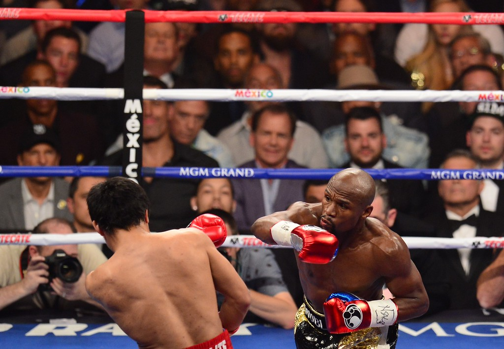 . Floyd Mayweather Jr. (R), and Manny Pacquiao fight in a welterweight unification bout on May 2, 2015 at the MGM Grand Garden Arena in Las Vegas, Nevada. AFP PHOTO / FREDERIC J. BROWNFREDERIC J. BROWN/AFP/Getty Images