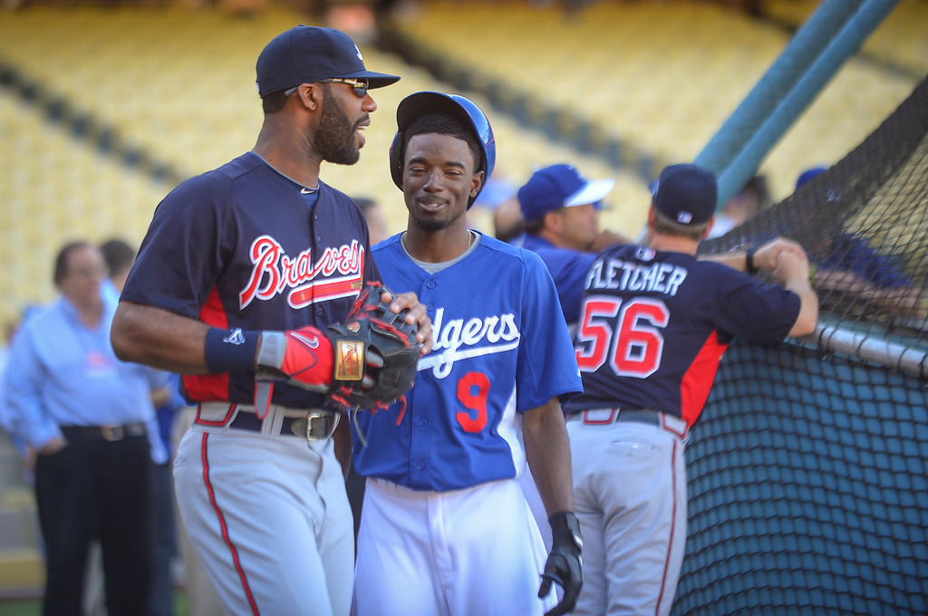 . The Dodgers\' Dee Gordon and Atlanta\'s Jason Heyward joke together before the start of game 4 of Dodgers vs Atlanta Monday, October 7, 2013 ( Photo by Andy Holzman/Los Angeles Daily News )
