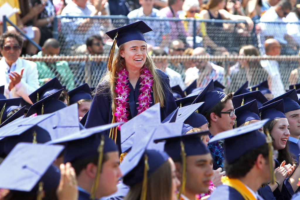 . Kazia Mermel walks up to the stage to collect an award during the Notre Dame High School graduation commencement on the high school football field on Saturday, June 01, 2013 in Sherman Oaks, CA.  Photo by Michael Yanow