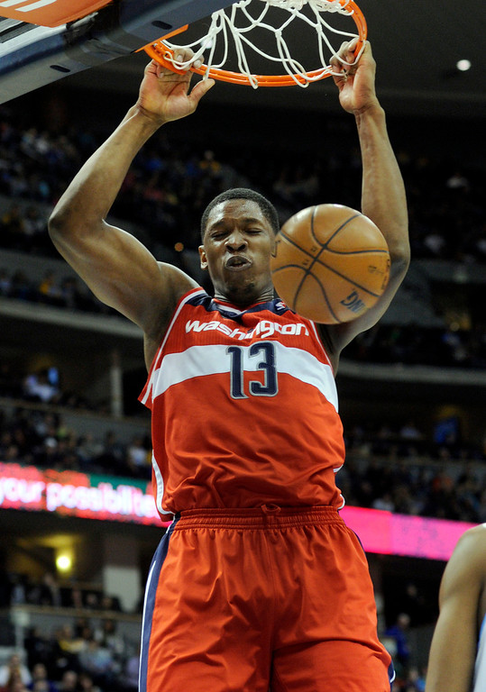 . DENVER, CO - JANUARY 18: Washington center Kevin Seraphin (13)_ pounded the ball through the hoop in the second half. The Washington Wizards defeated the Denver Nuggets 112-108 at the Pepsi Center Friday night, January 18, 2013. Karl Gehring/The Denver Post