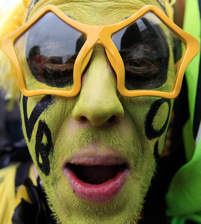. A Borussia Dortmund supporter reacts during a public viewing of the Champions League Final soccer match between Borussia Dortmund and Bayern Munich in Dortmund, Germany, Saturday, May 25, 2013. (AP Photo/Frank Augstein)