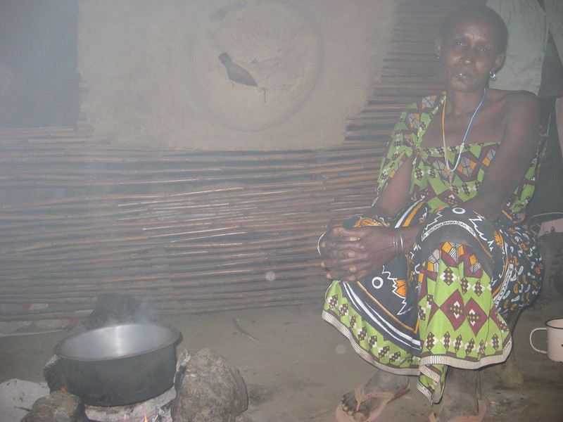 Woman cooking: There is no roof vent for the smoke to exit so it's very smokey inside.