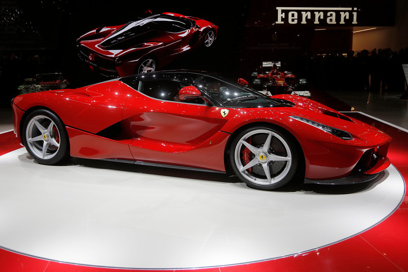 . The new Ferrari, named LaFerrari, is presented during the first media day of the 83rd Geneva International Motor Show, Switzerland, Tuesday, March 5, 2013. The Motor Show will open its gates to the public from March 7 to 17.  (AP Photo/Laurent Cipriani)