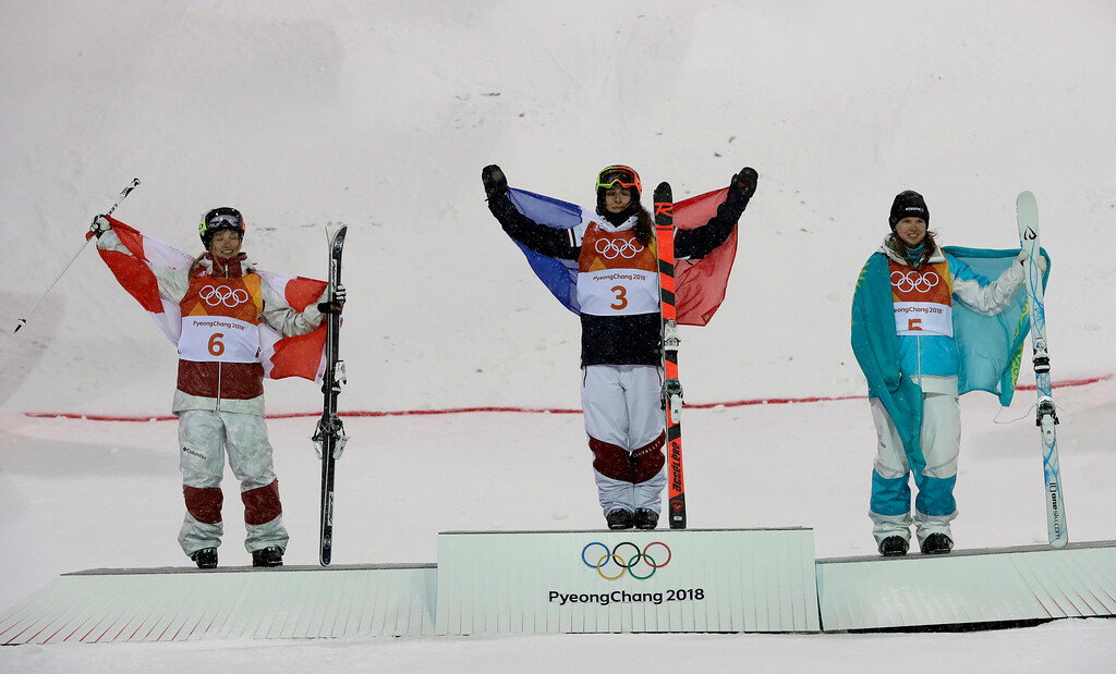 . From left; Silver medal winner Justine Dufour-Lapointe, of Canada, Gold medal winner Perrine Laffont, of France, and bronze medal winner Yulia Galysheva, of Kazakhstan, celebrate after the women\'s moguls finals at Phoenix Snow Park at the 2018 Winter Olympics in Pyeongchang, South Korea, Sunday, Feb. 11, 2018. (AP Photo/Kin Cheung)