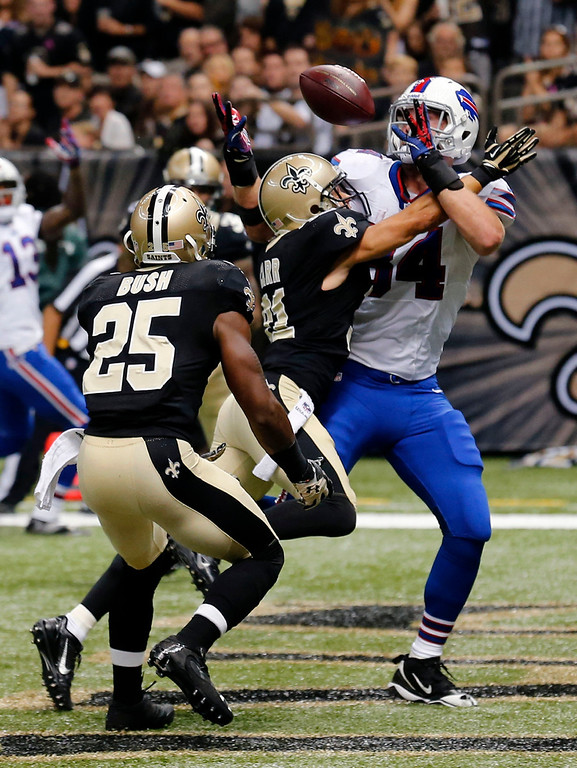 . New Orleans Saints defensive back Chris Carr (31) breaks up a pass intended for Buffalo Bills tight end Scott Chandler (84) during the first half of an NFL football game in New Orleans, Sunday, Oct. 27, 2013. (AP Photo/Bill Haber)