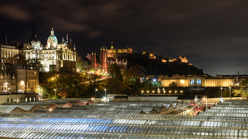Edinburgh Castle and Waverley Station at night