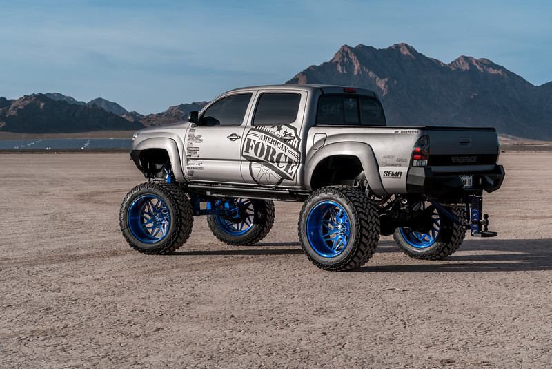 @T_harper96 @Vengeance_tacoma 2005-15 Toyota Tacoma featuring our New 2019 Concave 24x14 Lollipop Blue #GENESIS wrapped in 40x1550x24 @NittoTire-74.jpg