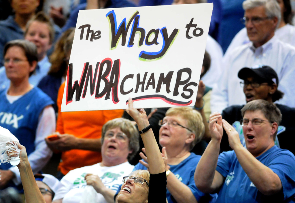 ". A happy Lynx fan holds up a sign that reads ""The Whay to WNBA champs,\"" in reference to Lindsay Whalen, during the fourth quarter of Minnesota\'s 84-59 drubbing of Atlanta. (Pioneer Press: Sherri LaRose-Chiglo)"