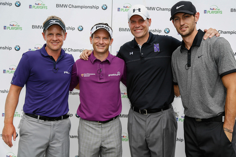 Luke Donald, Mark Wilson, Chris Collins and Kirk Hinrich pose for a photo following play in the BMW Championship Exhibition at Conway Farms Golf Club on Monday, Aug. 12. The nine-hole exhibition raised $45,000 for the Evans Scholars Foundation, the sole beneficiary of the BMW Championship.  The BMW Championship, the third of four events in the PGA TOUR's FedExCup Playoffs, will be held the week of Sept. 9-15 at Conway Farms. WGA Photo/Charles Cherney)