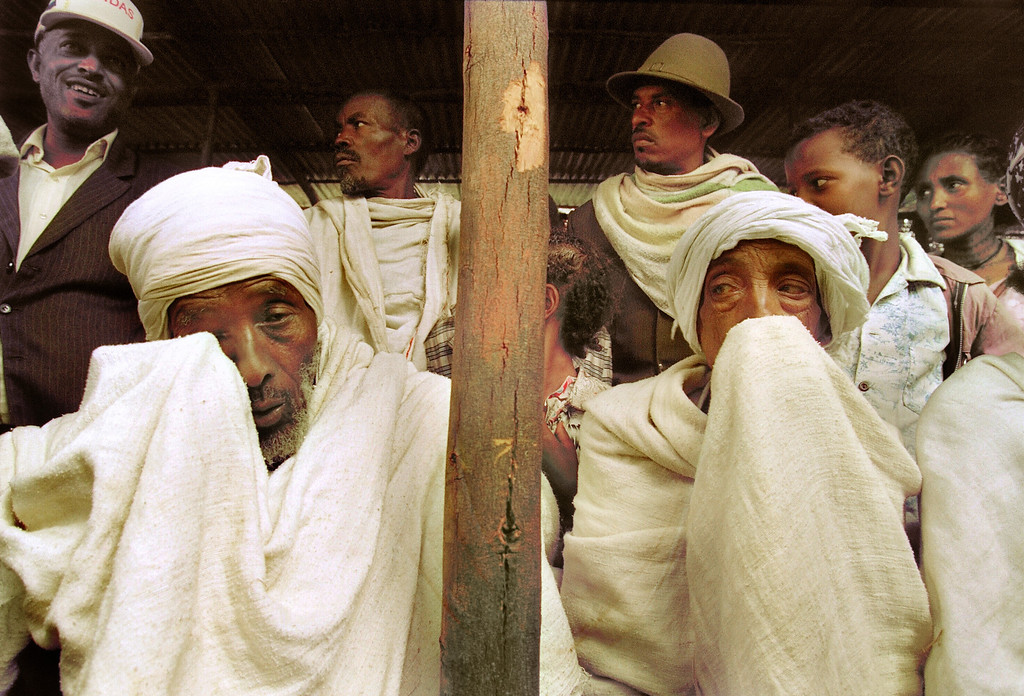 """. ADDIS ABEBA, ETHIOPIA:  Ethiopian Jews, known as \""""Falasha\"""", wait at the Israeli embassy, 24 May 1991, in Addis Ababa, to be bussed to the airport. Israel is planning to take about 1,000 refuges a week out of the country as the civil war continues. JEROME DELAY/AFP/Getty Images"""