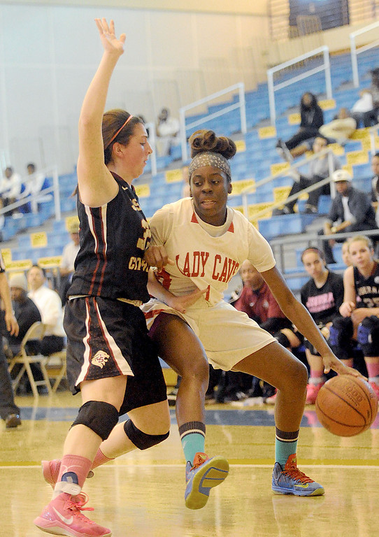 . 03-12-2013--(LANG Staff Photo by Sean Hiller)-Serra\'s Nautica Morrow (1) drives against JSerra\'s Corinne Bogle in Tuesday\'s girls basketball IV Southern California Regional semifinal at L.A. Southwest College.