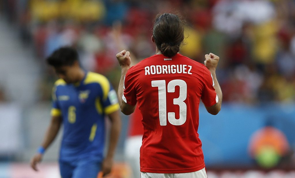 . Switzerland\'s defender Ricardo Rodriguez (R) celebrates after a Group E football match between Switzerland and Ecuador at the Mane Garrincha National Stadium in Brasilia during the 2014 FIFA World Cup on June 15, 2014.  AFP PHOTO / ADRIAN DENNIS
