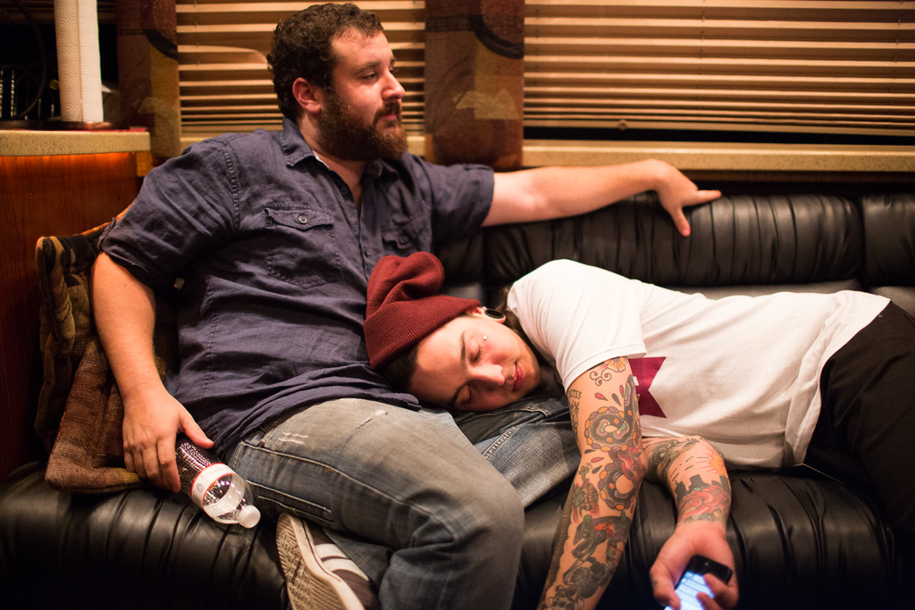 Kevin Puig, tour manager, doubles as Tony's pillow.