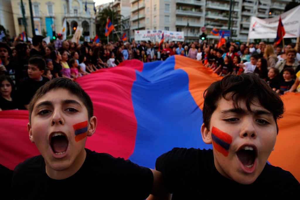 . Armenian boys shout slogans against Turkey in front of a huge Armenian flag during a demonstration near the Turkish embassy in central Athens, April 24, 2013 in central Athens. Hundreds of Armenians marched to commemorate the 98th anniversary of the mass killing of Armenians in the Ottoman Empire in 1915. Twenty one countries worldwide, including Greece, Russia, and France as well as the European parliament recognize the mass killings as an act of genocide, despite strong objections from Turkey. REUTERS/Yannis Behrakis
