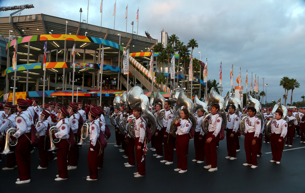 Description of . The Florida State Seminoles marching band line up outside the stadium prior to the Seminoles playing against the Northern Illinois Huskies during the Discover Orange Bowl at Sun Life Stadium on January 1, 2013 in Miami Gardens, Florida.  (Photo by Streeter Lecka/Getty Images)