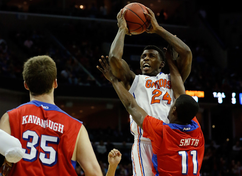 . Casey Prather #24 of the Florida Gators takes a shot as Scoochie Smith #11 of the Dayton Flyers defends during the south regional final of the 2014 NCAA Men\'s Basketball Tournament at the FedExForum on March 29, 2014 in Memphis, Tennessee.  (Photo by Kevin C. Cox/Getty Images)