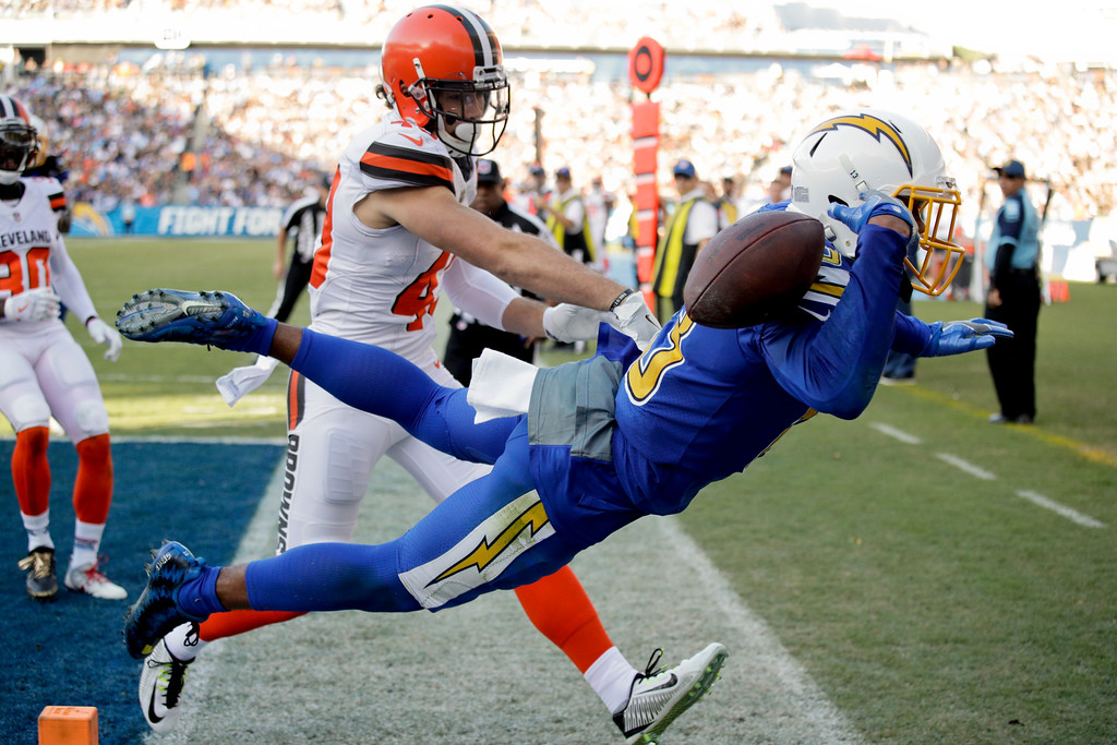 . Cleveland Browns defensive back Kai Nacua, left, breaks up a pass intended for Los Angeles Chargers wide receiver Keenan Allen during the second half of an NFL football game Sunday, Dec. 3, 2017, in Carson, Calif. (AP Photo/Jae C. Hong)