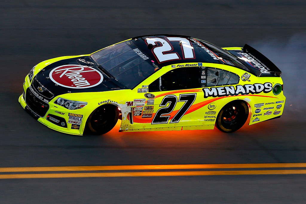 . DAYTONA BEACH, FL - JULY 06:  Paul Menard, driver of the #27 Rheem / Menard\'s Chevrolet, has his car flame up underneath as he races during the NASCAR Sprint Cup Series Coke Zero 400 at Daytona International Speedway on July 6, 2013 in Daytona Beach, Florida.  (Photo by Scott Halleran/Getty Images)