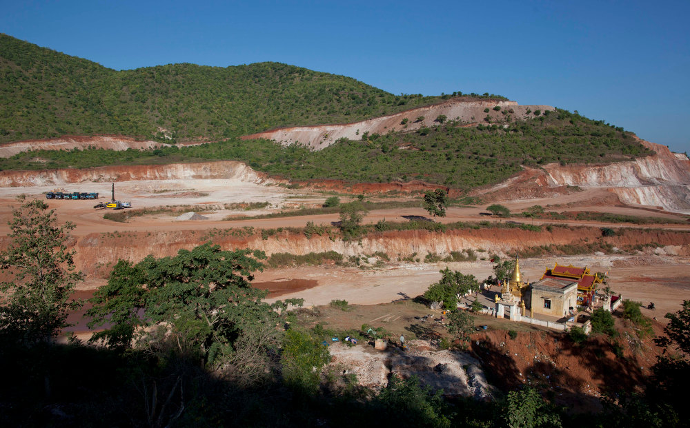 . A Buddhist shrine, bottom right, that is schedule to be dismantled for the expansion of the Letpadaung mine in Monywa town, northwestern Myanmar, Wednesday, Nov 28, 2012. Hundreds of Buddhist monks and villagers occupying a Letpadaung mine defied a government order to leave by Wednesday, saying they will stay until the project is halted. The protest is the latest example of increased activism by citizens since an elected government took over last year following almost five decades of repressive military rule. (AP Photo/Gemunu Amarasinghe)