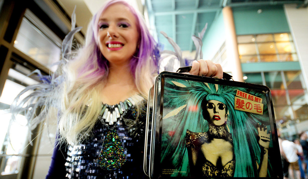 . Marti Boe from Edina shows off her Lady Gaga lunchbox as she waits to get into the Xcel Energy Center.  (Pioneer Press: John Autey)