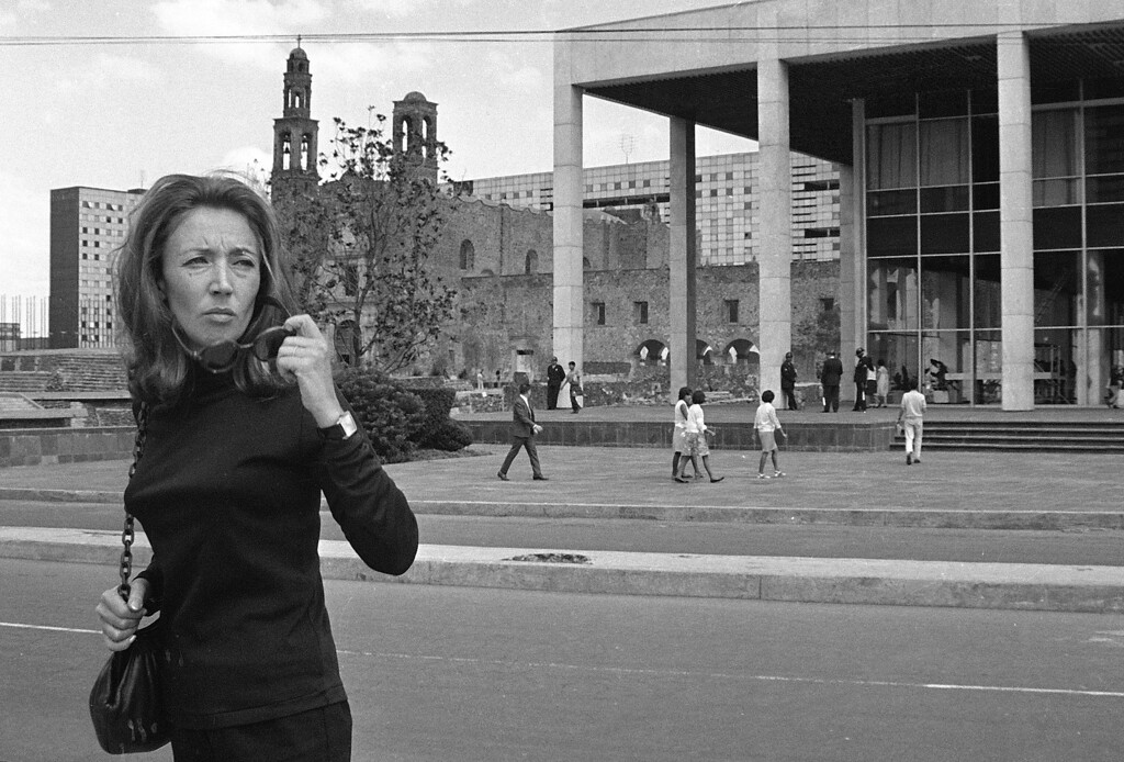 . Italian journalist Oriana Fallaci crosses Avenida San Juan de Letran in Mexico City, Mexico, Oct. 15, 1968. Fallaci is a few blocks away from the spot where she was shot Oct. 2 while covering the police occupation of the local university.  In the background is the church of Santiago de Tlatelolco and a portion of building over-looking the Plaza de Les tres Cultures.  (AP Photo)