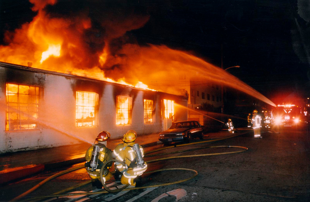 . Hawthorne firefighters battle a fire at the South Bay Lutheran High School Thrift Shop on Prairie Ave. in Hawthorne during the L.A. Riots. Daily Breeze File Photo