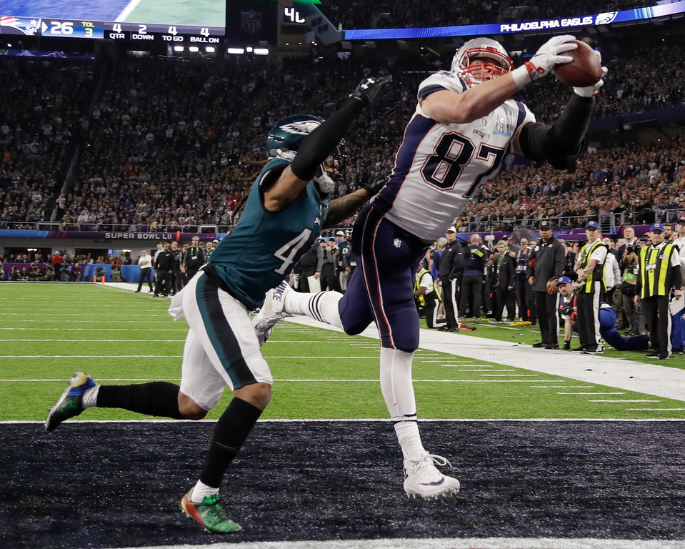 . New England Patriots\' Rob Gronkowski (87) makes a touchdown reception against Philadelphia Eagles cornerback Ronald Darby (41), during the second half of the NFL Super Bowl 52 football game, Sunday, Feb. 4, 2018, in Minneapolis. (AP Photo/Chris O\'Meara)