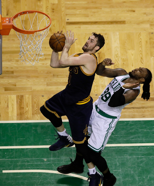 . Cleveland Cavaliers forward Kevin Love, left, drives to the basket in front of Boston Celtics forward Jae Crowder during the second quarter of Game 1 of the NBA basketball Eastern Conference finals, Wednesday, May 17, 2017, in Boston. (AP Photo/Charles Krupa)