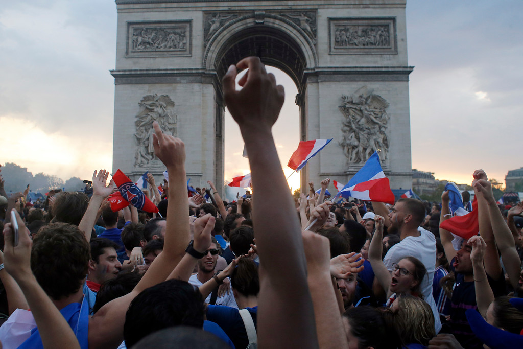 . People take the streets around the Arc de Triomphe to celebrate France\'s World Cup victory over Croatia, in Paris, France, Sunday, July 15, 2018. France won the final 4-2. (AP Photo/Thibault Camus)