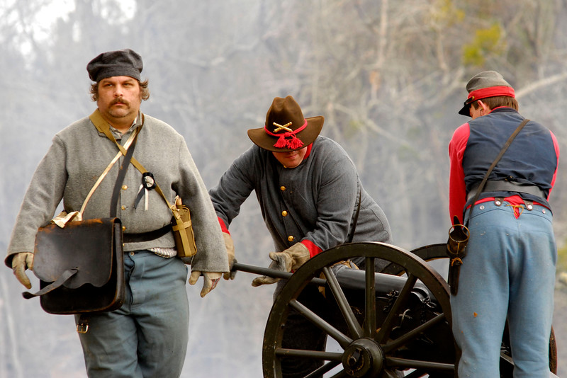 An artillery reenactor rams the ammo into a Mountain Howitzer. The Skirmish at Gamble's Hotel happened on March 5, 1885 when 500 federal soldiers, under the command of Reuben Williams of the 12th Indiana Infantry, marched into Florence to destroy the railroad depot but were met by Confederate soldiers backed up with 400 militia. The reenactment, held by the 23rd South Carolina Infantry, was held at the Rankin Plantation in Florence, South Carolina on Saturday, March 5, 2011. Photo Copyright 2011 Jason Barnette