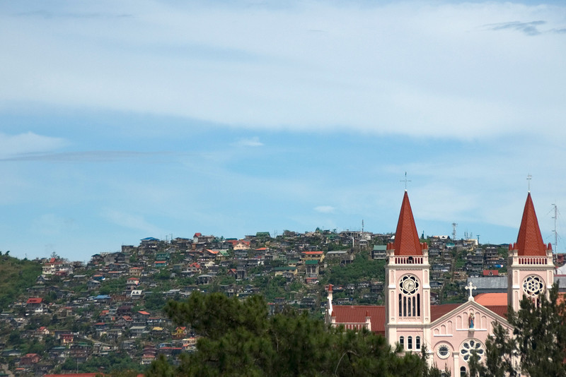 Overlooking shot of the Baguio Cathedral and city skyline - Baguio, Philippines