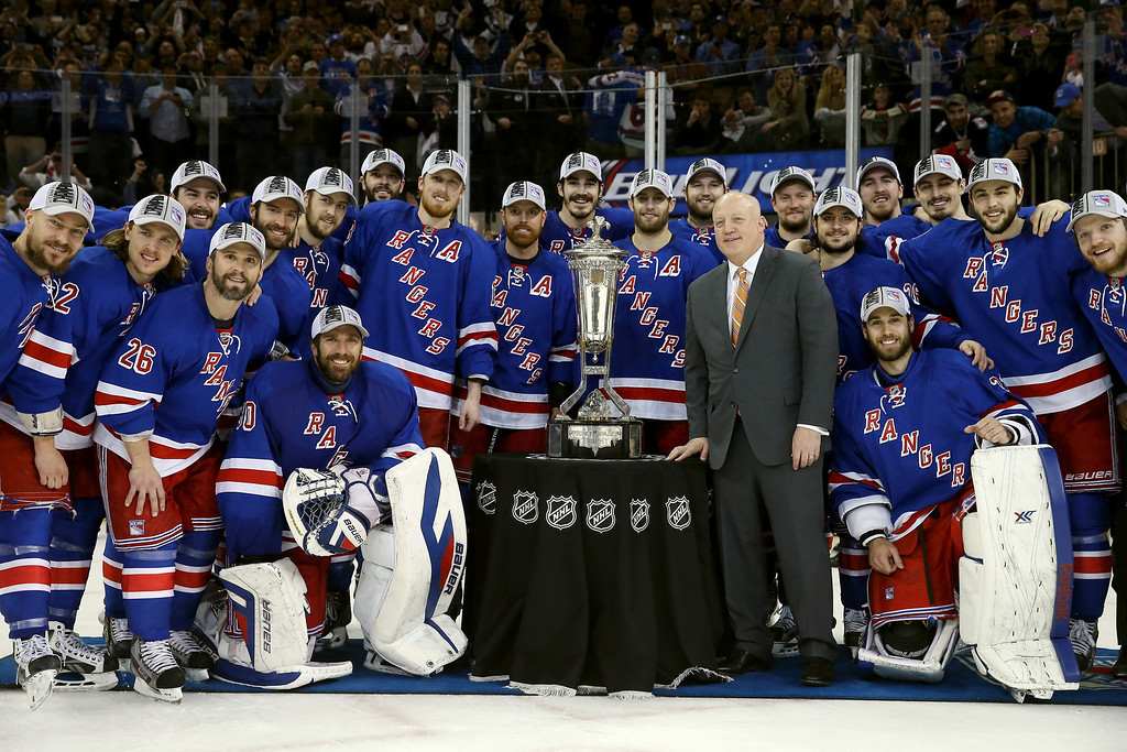 . The New York Rangers pose with Deputy Commissioner Bill Daly and the Prince of Wales Trophy after defeating the Montreal Canadiens in Game Six to win the Eastern Conference Final in the 2014 NHL Stanley Cup Playoffs at Madison Square Garden on May 29, 2014 in New York City. The New York Rangers defeated the Montreal Canadiens 1 to 0.  (Photo by Bruce Bennett/Getty Images)