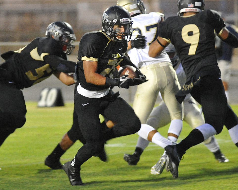 . Northview\'s Nicholas Ybarra #21) runs in for a touchdown as they play Rowland in their non-league game at Covina District Field in Covina on Friday September 13, 2013.  (San Gabriel Valley Tribune/Staff Photo by Keith Durflinger)
