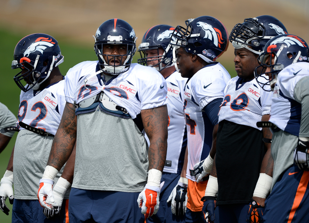 . Denver Broncos defensive tackle Kevin Vickerson (99) in drills during practice August 26, 2014 at Dove Valley.(Photo by John Leyba/The Denver Post)