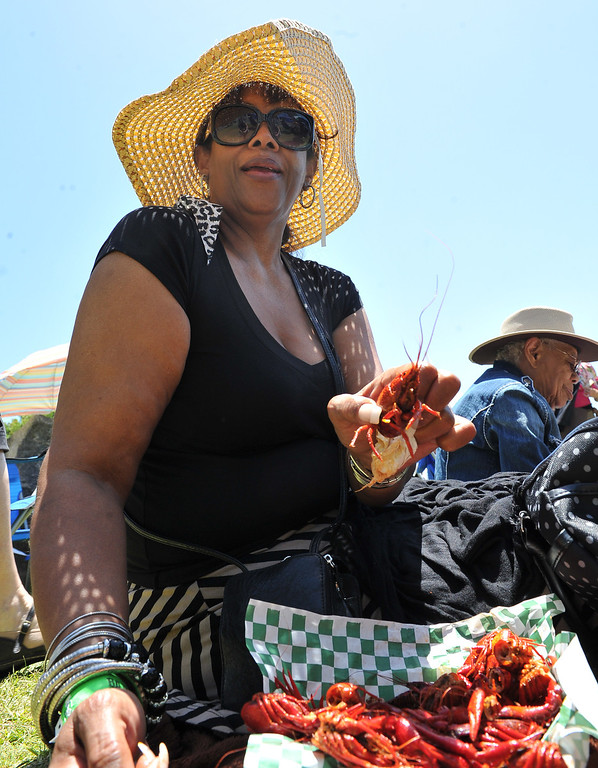 . 6/22/13 - Pennie Ellis enjoys fresh crawfish at the 27th Annual Long Beach Bayou and Blues Festival at Rainbow Harbor. Photo by Brittany Murray / Staff Photographer