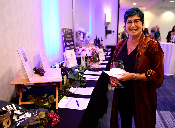 3/23/2019 Mike Orazzi | Staff Penny Young looks over silent auction items during the Bristol Hospital Development Foundation's annual Festival of Wine and Spirits held at the DoubleTree by Hilton Hotel in Bristol Saturday night.