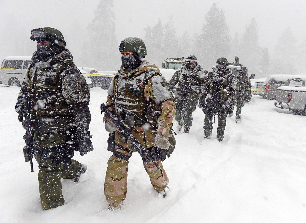. A San Bernardino County Sheriff SWAT team returns to the command post at Bear Mountain in Big Bear after searching for Christopher Jordan Dorner Friday February 8, 2013. Search conditions have been hampered as a heavy winter storm has hit the area. (Staff photo by Will Lester)