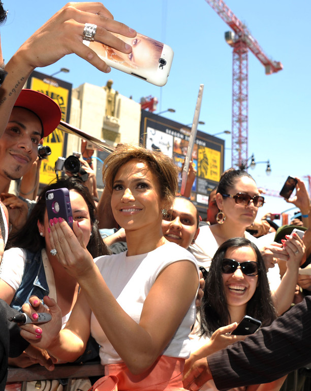. Jennifer Lopez greets fans at a ceremony honoring her with a star on the Hollywood Walk of Fame on Thursday, June 20, 2013 in Los Angeles. (Photo by John Shearer/Invision/AP)