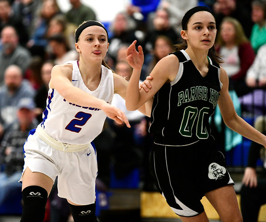 2/28/2019 Mike Orazzi | Staff St. Paul Girls Basketball's Kailyn Bielecki (2) and Parish Hill's Violet Andrews (00) during the Class S Second Round State Girls Basketball Tournament in Bristol Thursday night.