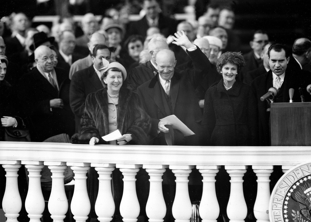 . U.S. President Dwight Eisenhower acknowledges applause as he stands on the Capitol inaugural stand with first lady Mamie Eisenhower, left, in Washington, D.C., Jan. 21, 1957. Vice President Richard Nixon is at far right, with his wife, Pat, second from right. (AP Photo)