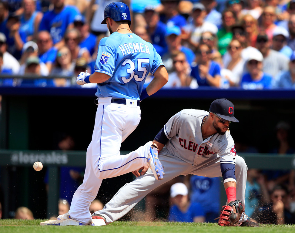 . Kansas City Royals\' Eric Hosmer (35) reaches the bag as the ball gets past Cleveland Indians first baseman Carlos Santana, right, during the fifth inning of a baseball game at Kauffman Stadium in Kansas City, Mo., Saturday, June 3, 2017. Hosmer was safe at first base on a wild-pitch strike out. (AP Photo/Orlin Wagner)