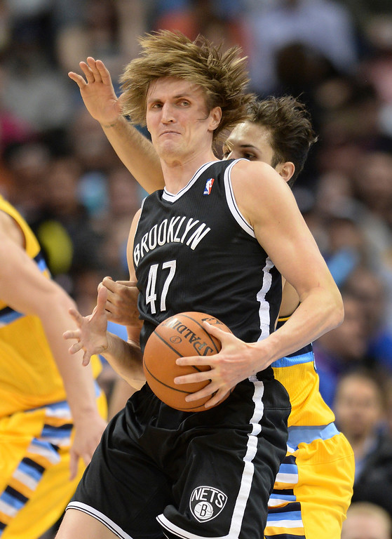. DENVER, CO. - FEBRUARY 27, 2014: Brooklyn forward Andrei Kirilenko (47) made a move around Denver defender Evan Fournier in the first half. The Denver Nuggets hosted the Brooklyn Nets at the Pepsi Center Thursday night, February 27, 2014. Photo By Karl Gehring/The Denver Post