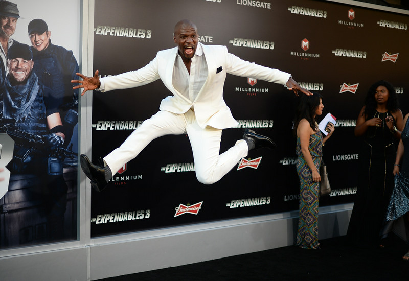 ". Terry Crews arrives at the premiere of ""The Expendables 3\"" at TCL Chinese Theatre on Monday, Aug. 11, 2014, in Los Angeles. (Photo by Jordan Strauss/Invision/AP)"
