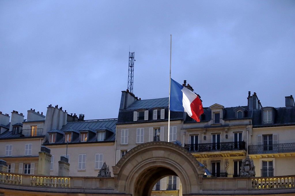 . A French flag flies half-mast at the Elysee Palace in Paris on January 8, 2015,  on a day of mourning following an attack on January 7 by armed gunmen on the offices of French satirical weekly Charlie Hebdo. A stunned and outraged France began a national day of mourning on January 8, as security forces desperately hunted two brothers suspected of gunning down 12 people in an Islamist assault on a satirical weekly, the country\'s bloodiest attack in half a century.  AFP PHOTO / PATRICK  KOVARIK/AFP/Getty Images