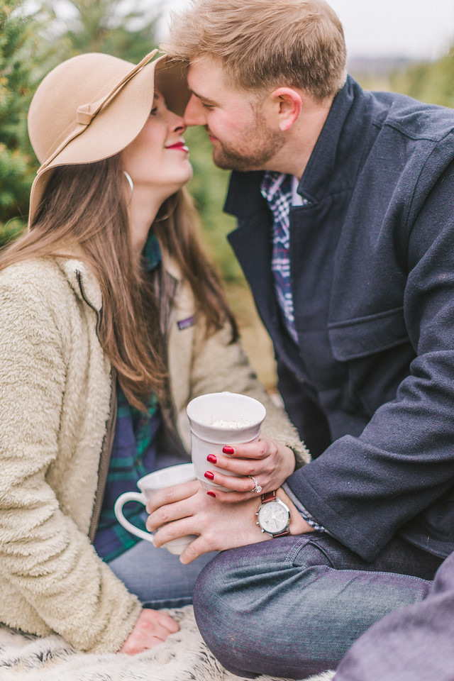 Lizzie and Craig's Christmas tree engagement shoot at Graver Farm with hot cocoa.