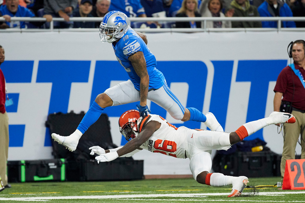 . Detroit Lions wide receiver Kenny Golladay (19) leaps over Cleveland Browns strong safety Derrick Kindred (26) during an NFL football game, Sunday, Nov. 12, 2017, in Detroit. (AP Photo/Rick Osentoski)