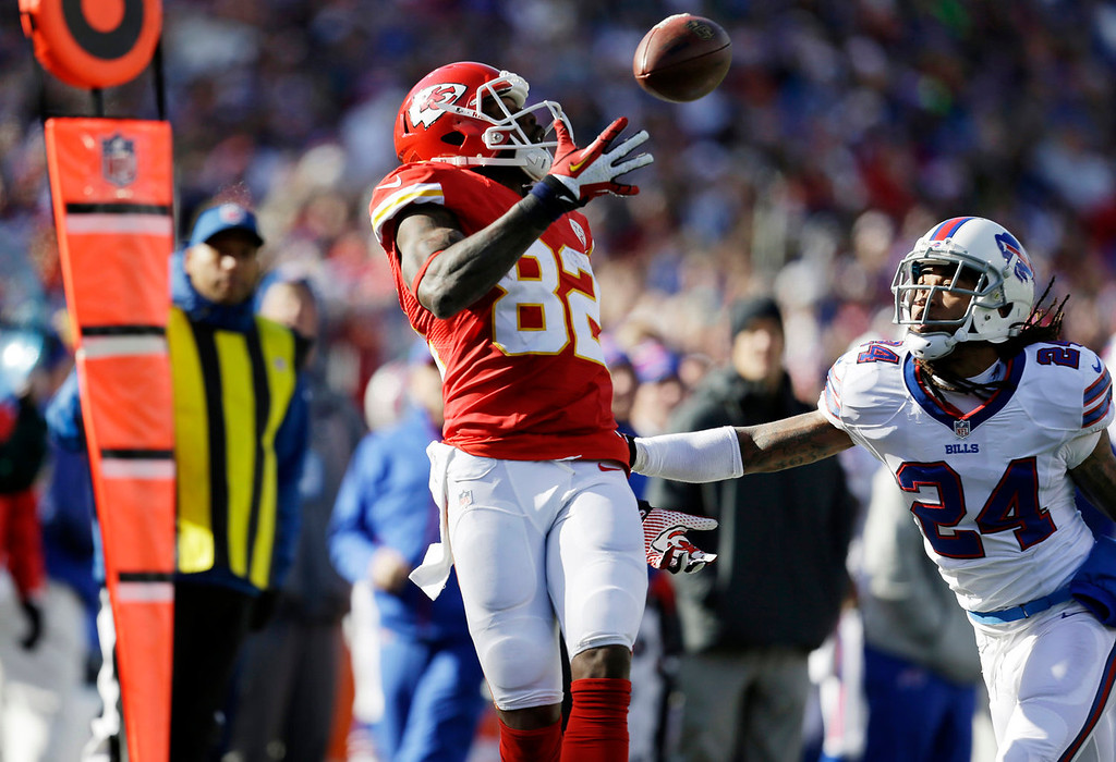 . Kansas City Chiefs wide receiver Dwayne Bowe (82) hauls in a pass behind Buffalo Bills cornerback Stephon Gilmore (24) for a 10-yard gain during the second quarter of an NFL football game in Orchard Park, N.Y., Sunday, Nov. 3, 2013. (AP Photo/Bill Wippert)