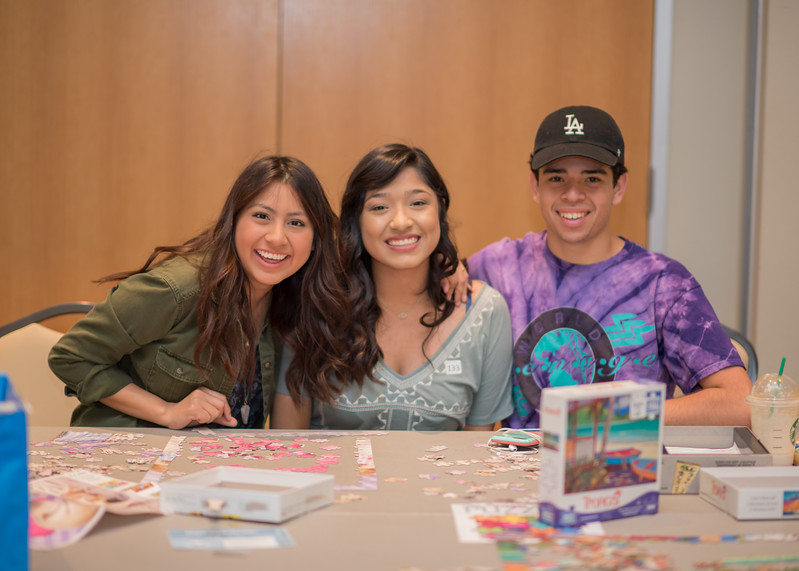 Giselle Guzman (left), Daisy Garcis, Sam Trujillo put together puzzles during PAWS on the Island.